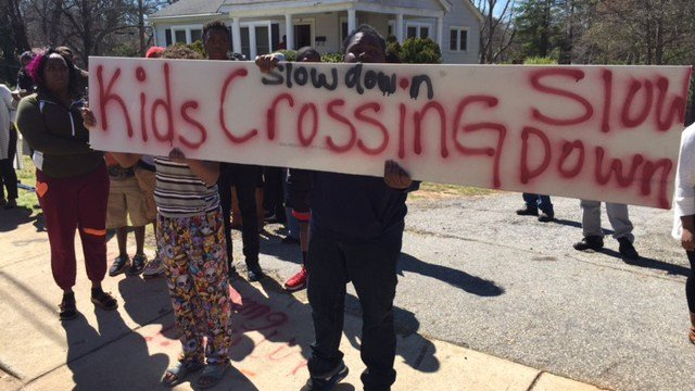 Some people held sings warning drivers to slow down in the area. (March 19, 2017 FOX Carolina)