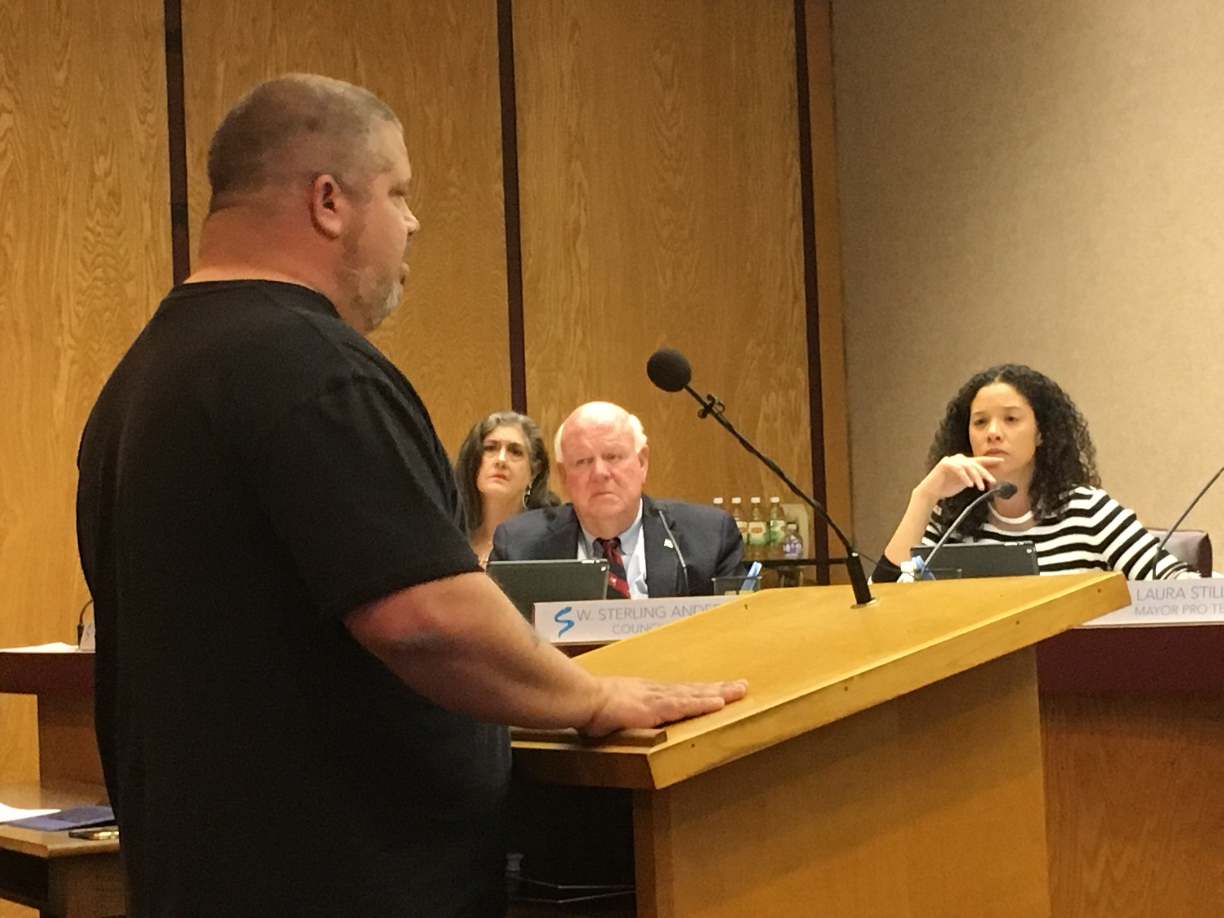 A tow truck operator speaks before council members Monday