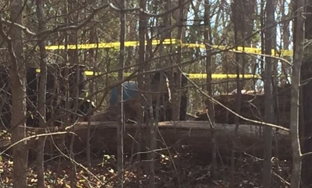 Police tape marks the location of the well where officials said the man was found (FOX Carolina/ March 21, 2017)