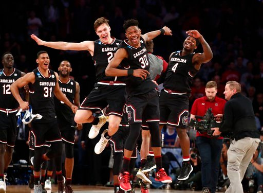 USC men's basketball celebrates stunning win over Baylor (Source: Associated Press)