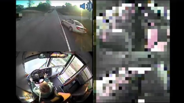 Car swerves around bus (Source: Greenville Co. Schools)