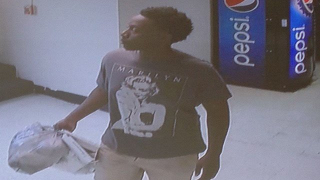 Suspect after wallet in wheelchair looted (Source: GPD)