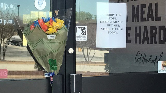 Flowers put out on front door at  KFC in Spartanburg. (April 1, 2017 FOX Carolina)