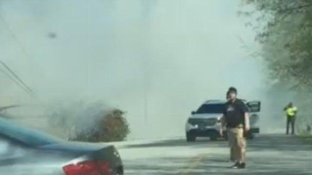 Scene of brush fire near Avalon Apartments in Greenville. (April 6, 2017 FOX Carolina)