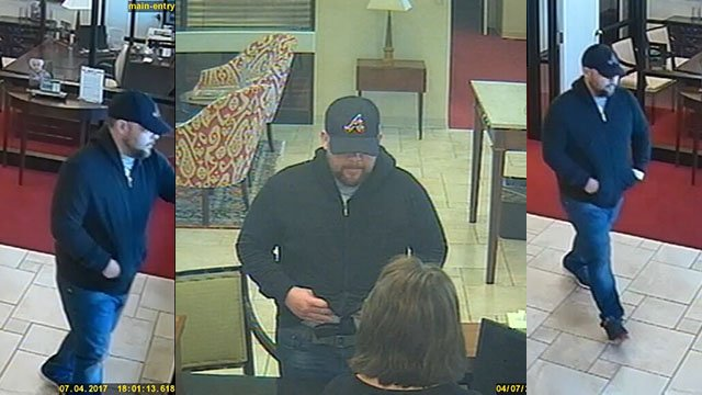 Surveillance footage of armed robbery suspect at First Citizens Bank on Smokey Park Hwy in Asehville. (Source: Asheville PD)