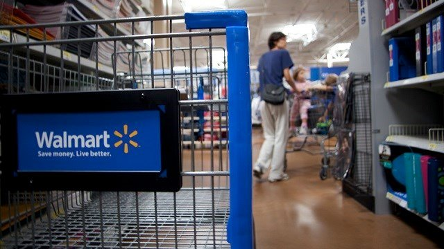 Interior of Wal-Mart store - close-up of shopping cart on aisle. (Credit: Ferre' Dollar/CNN)