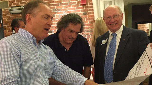 Mike Mecklenburg (center) with Mayor Knox White and Councilman George Fletcher (Source: Amy Doyle)