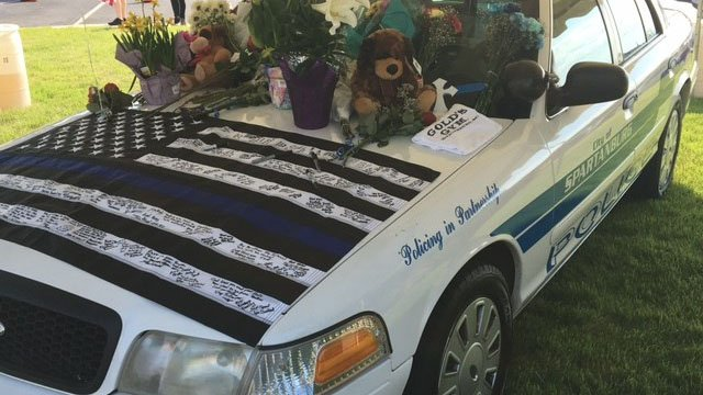 Patrol car memorial for Officer Harris (file/FOX Carolina)
