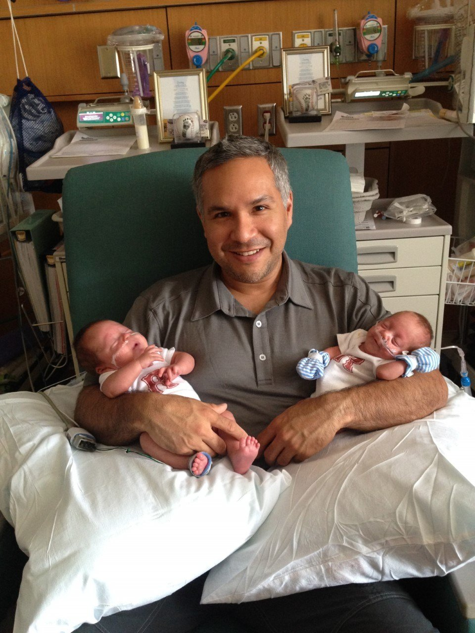 Adan Rodriguez holding his twin boys on his first Father's Day in 2014 (Courtesy: Cathy Rodriguez).