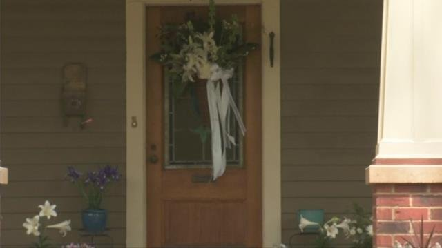 A wreath hangs on the door to Mike Mecklenburg's home. (April 17, 2017)