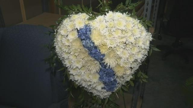 Heartbroken flower arrangement in honor of Spartanburg Police Department. (FOX Carolina/ April 18, 2017)