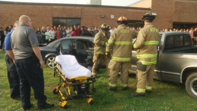 Firefighters rescue crash victims during DUI simulation at Boiling Springs High School (April 20, 2017)