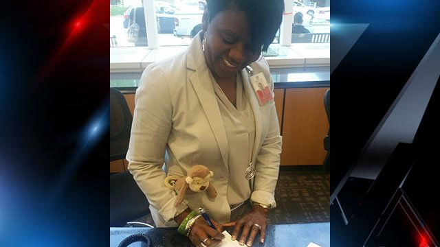 GSP employee cuddles up to stuffed monkey on the job. (Source: Rosylin Weston, GSP)