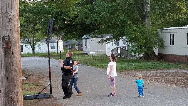 Iva officers play basketball with neighborhood kids. (Source: Jon Bannister)