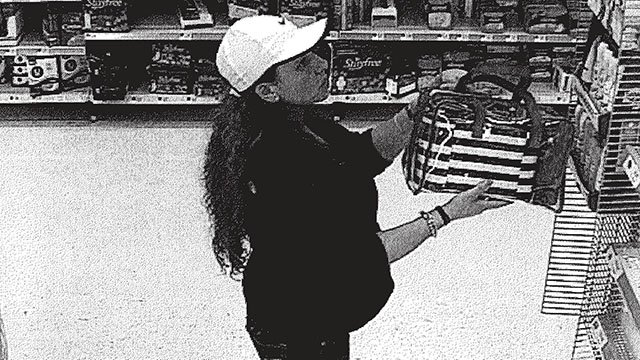 Female suspect caught on surveillance shopping with stolen debit card at TN Walmart (Source: Asheville PD Facebook)