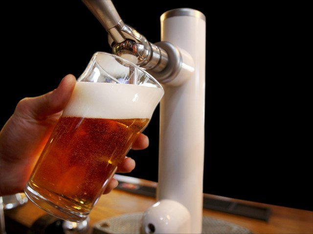 Bartender pours beer (Source: Associated Press)