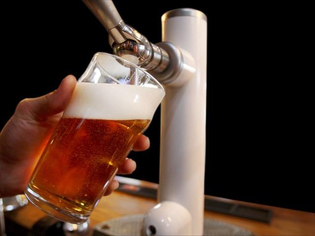 Bartender pours beer (Source: Associated Press)
