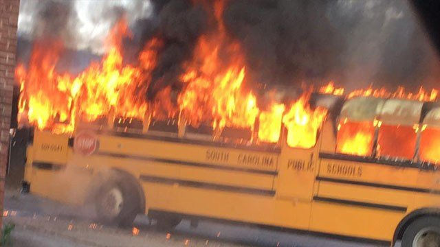 Photo of the bus in flames (Source: Kaye Gosnell)