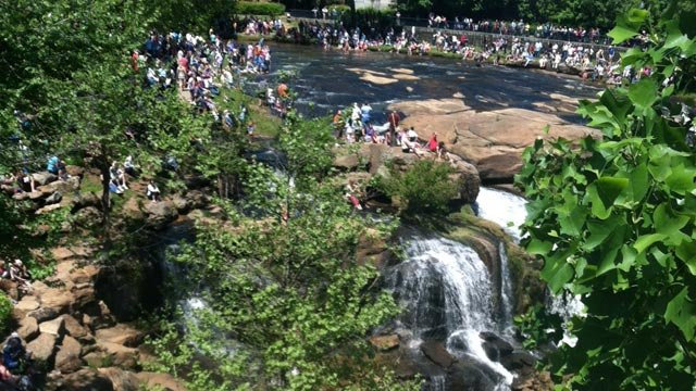 People enjoy the waterfall at Falls Park in Greenville, SC (FILE)