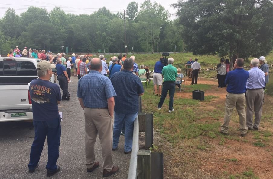 Residents gather to watch as the dam gates are closed. (FOX Carolina/ May 30, 2017)