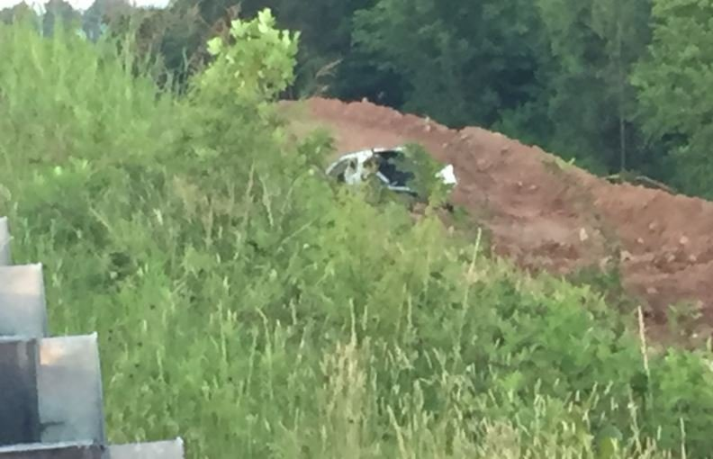 A heavily damaged vehicle could be seen down the embankment (FOX Carolina)