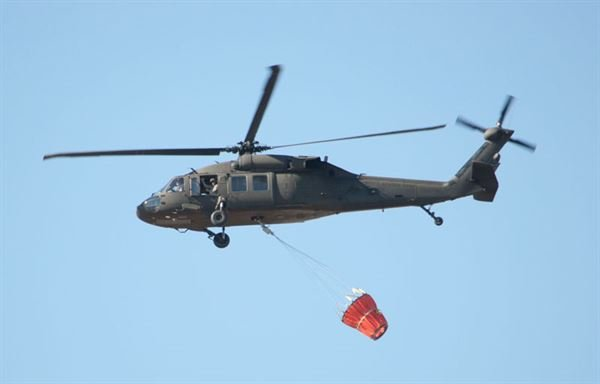 National Guard helicopter fights wildfire (Source: Dept. of Defense)