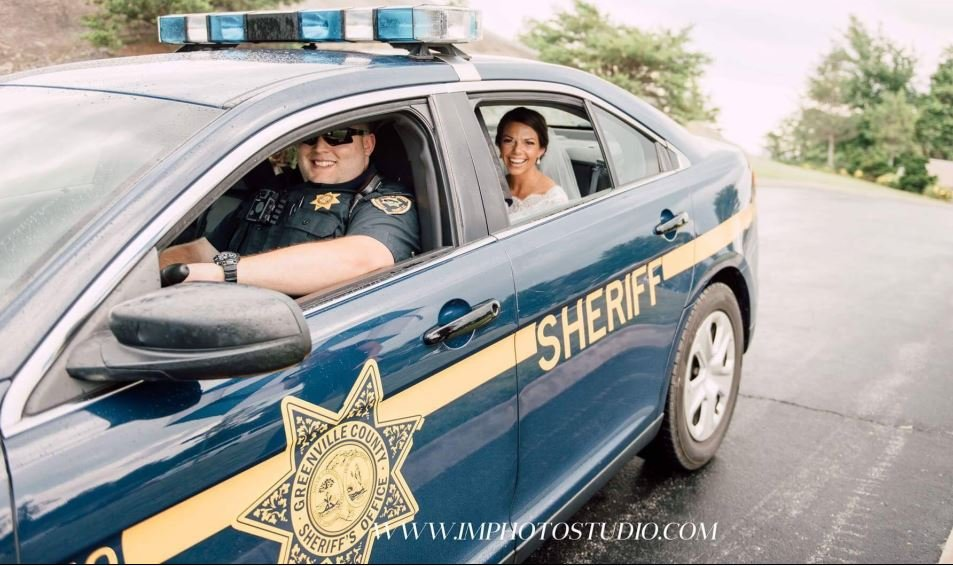 A deputy gives Kelly Bushey a ride to her wedding (Photo by Ina McConnell)