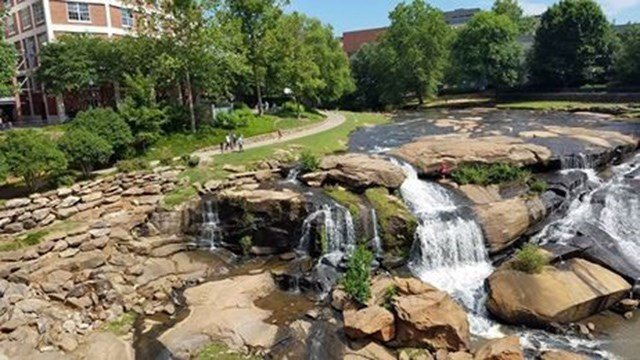 Man stuck in waterfall at Falls Park in Downtown Greenville. (Source: Greenville History Tours)