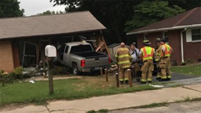 Scene of car into home on Pine Knoll Drive. (Source: Chastisy Casey)