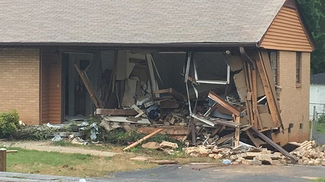 Scene of car into home on Pine Knoll Drive. (6/24/17 FOX Carolina)