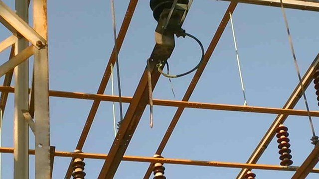 Snake hanging from substation equipment (Source: Ryan Mosier, Duke Energy)