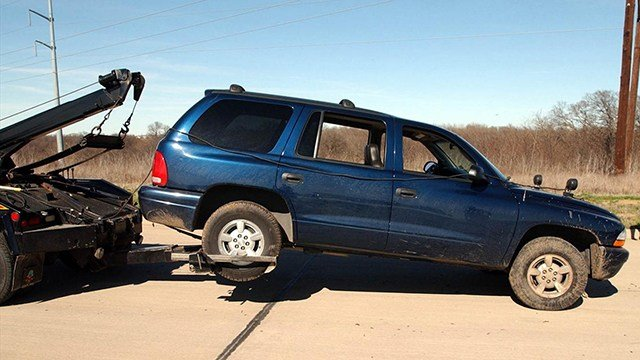Vehicle being towed (Source: Associated Press)