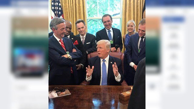 Easley pastor Mark Burns pictured among others who shared words of prayer with President Trump on Tuesday in the Oval Office (Source: Mark Burns Facebook)