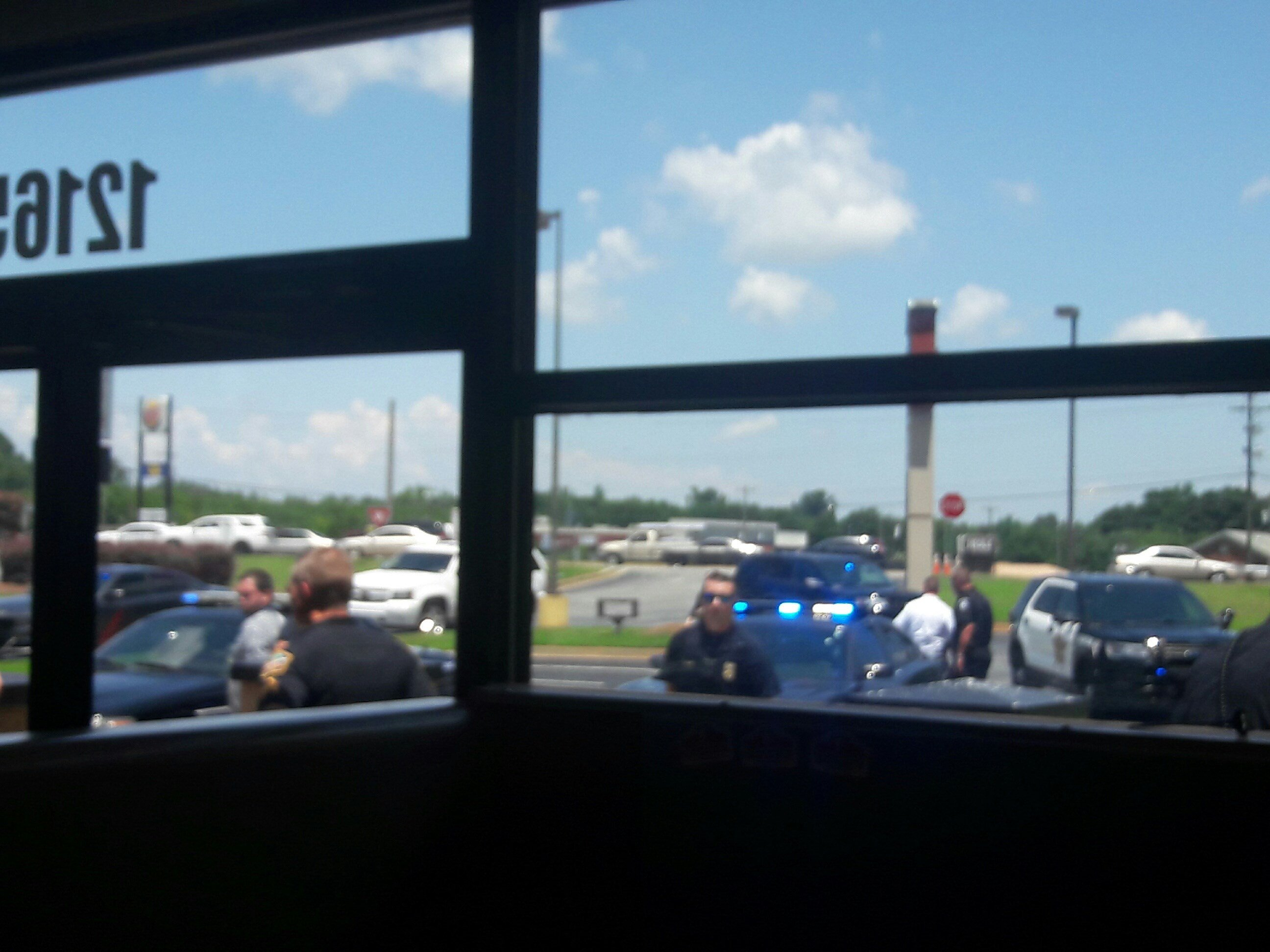 Authorities outside Papa John's (Source: Jacob Holland)