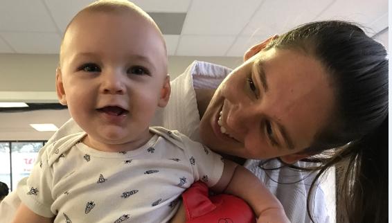 Greenville mother, Tyler Hudson holds 7-month-old son, Warrior