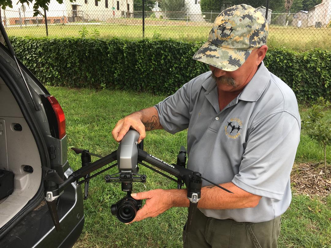 Drone Pilot, Greg Wieserman checks on his drone after discovering 2 cracks along Glendale Mill (July 25, 2017/FOX Carolina)