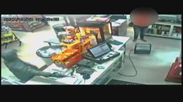 Screenshot from surveillance footage at MJ Foot Mart. (Source: ACSO)