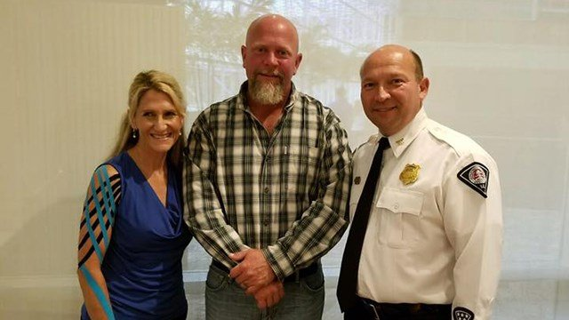 Douglas Dixon (center) saved a female victim's life (pictured left) from a dog attack. (Source: GPD)