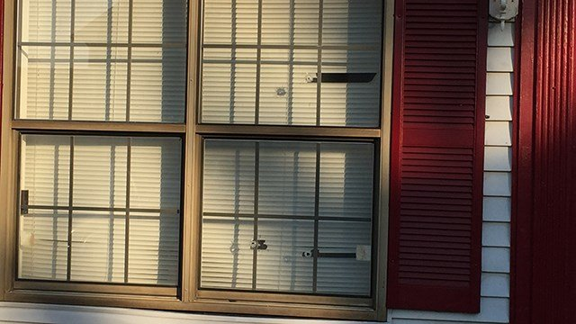 Bullet holes in apartment window on West Buford Street. (8/20/17 FOX Carolina)