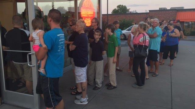 Customers lined up for Krispy Kreme's special eclispe edition donuts. (FOX Carolina/ 8/20/17)