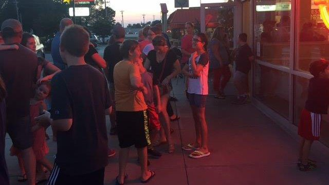 Customers lined up for Krispy Kreme's special eclispe edition donuts. (FOX Carolina/ 8/20/17)