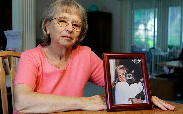 JoAnn Zywicki sits by a photo of her daughter Tammy at her home in Ocala, Fla. (AP Photo/John Raoux, file)