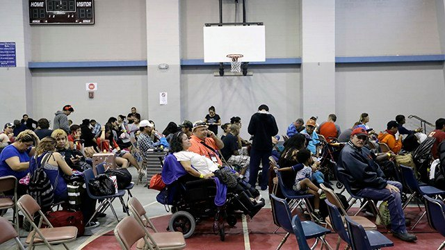 Residents wait at a high school gym before they are evacuated as the outer bands of Hurricane Harvey begin to make landfall. (Source: AP Images)