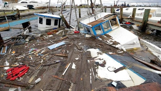 Boats that sunk in the wake of Hurricane Harvey are surrounded by floating debris Sunday, Aug. 27, 2017, in Rockport, Texas. (AP Photo/Eric Gay)
