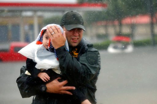 Child rescued from flood waters in TX (Source: Associated Press)