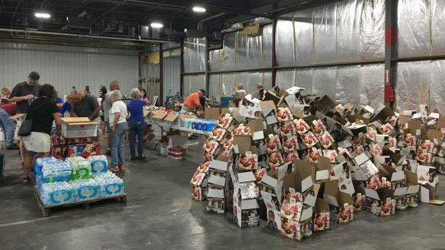Hearts with Hands volunteers packing boxes of food and goods to send to Texas (FOX Carolina/ 8/30/17)