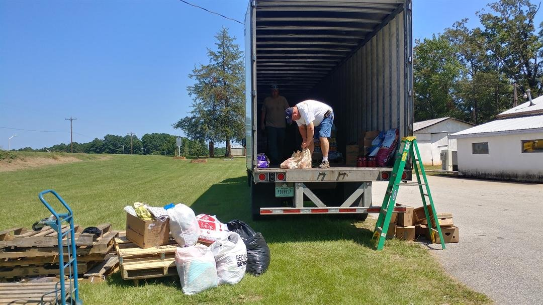 Volunteers load the trailer with donations. (Source: FOX Carolina/Sept. 4, 2017).