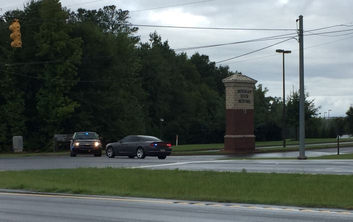 Law enforcement vehicles block the entrance to Dorman High School (FOX Carolina/ 9/12/2017)