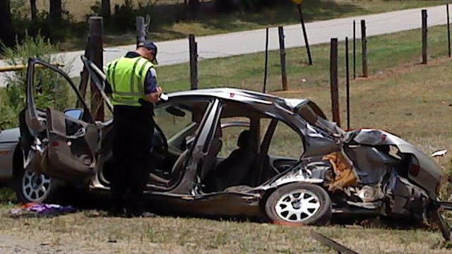 A crumpled car sits on the side of Highway 29 in Anderson County after a fatal crash. (June 14, 2011/FOX Carolina)