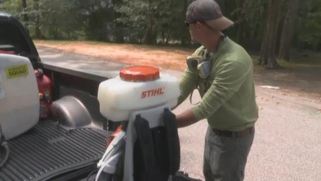 Technician prepares to spray yard for mosquitoes. (FOX Carolina/ Sept. 19, 2017)
